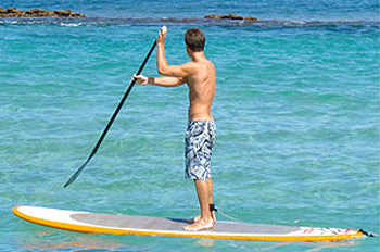 Man on a stand up paddle board in the ocean