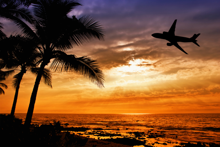 Airplane in Hawaii sunset